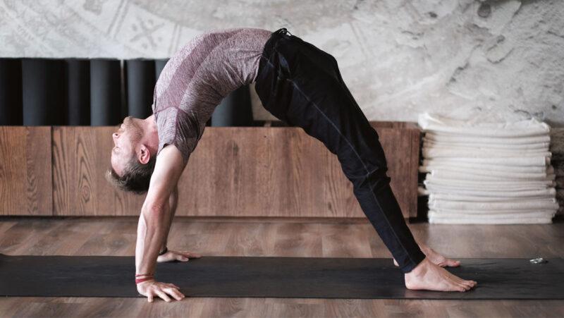Davin Jones - man on the mat - full wheel pose