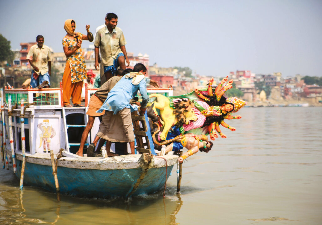 They make an offering into the Ganges.