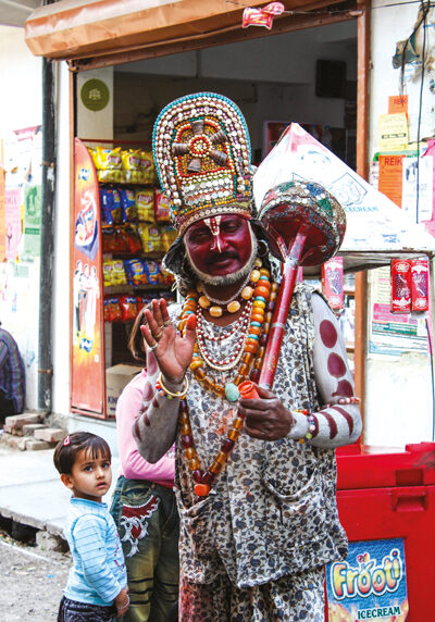 Hanuman (man dressed up with face painted)